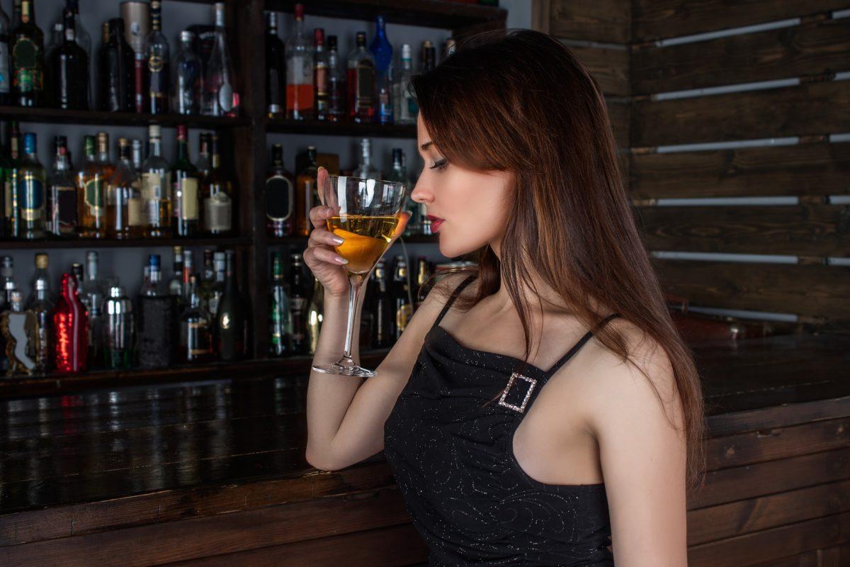beautiful-girl-tasting-white-wine-in-bar